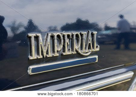 Chrysler Imperial Emblem On Display