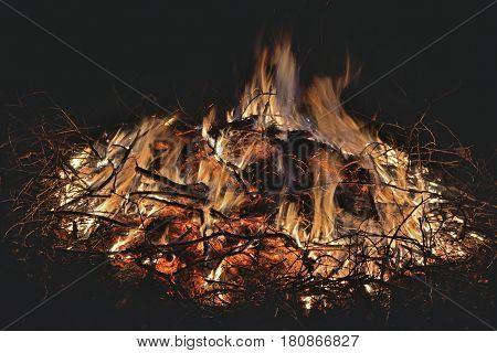 A close up of the aflame big bonfire.
