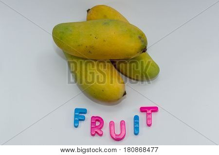 Business & creative concept,Fruit word on white background with close up of mango fruits.
