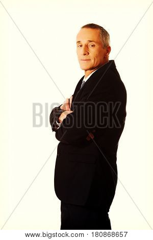 Businessman standing with folded arms