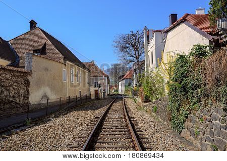 The railway through the fair municipality of Weissenkirchen in der Wachau. The District of Krems-Land, Lower Austria.