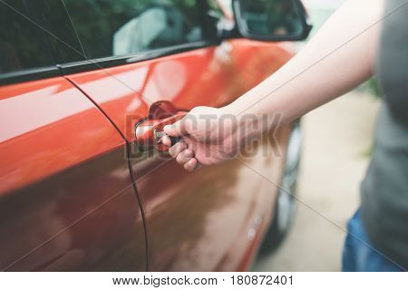 Asian man opening a car with keytransportation and ownership concept