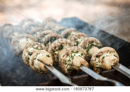 Grilled Mushrooms On Skewers Cooked In A Brazier, Close-up, Retro Effect