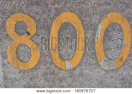 asphalt texture, yellow sign numbers , backround
