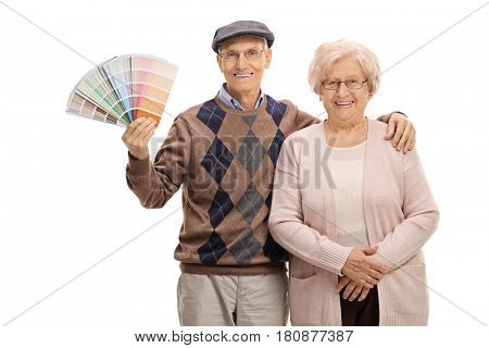 Elderly couple with a color swatch isolated on white background