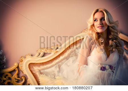 Portrait of a beautiful blonde women with bridal makeup and curls. Tenderness.
