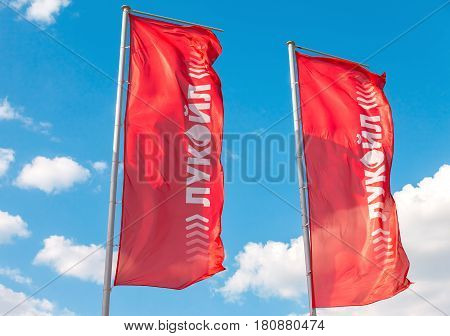 Samara Russia - april 16 2016: The flags of the oil company Lukoil against the blue sky. Lukoil is one of the largest russian oil companies