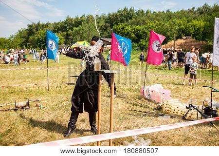 Samara Russia - june 18 2016: Traditional folk competition in the cutting of the Cossack saber