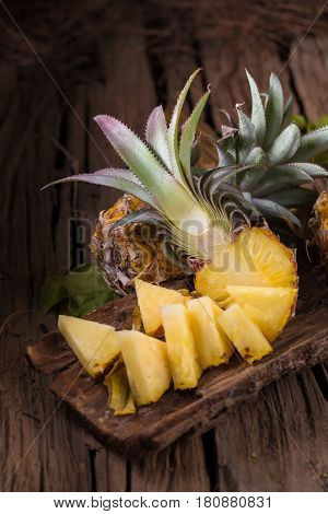 Pineapple Slices And Pineapple Shelled Asian-style On The Old Wooden Background. Tropical Fruit Conc