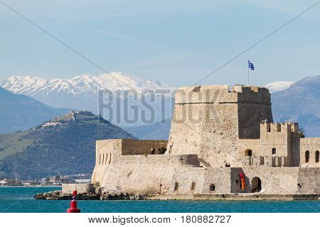 Venetian Castle Fortaleza de Bourtzi located on an island off the coast of Naplion with Mountains in the Background in Argolida Greece