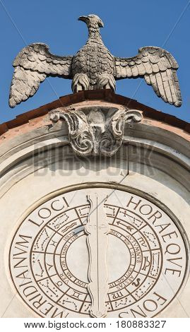 Varese (Lombardy Italy): the historic palace known as Palazzo Estense hosting the town hall. Sundial and statue of eagle