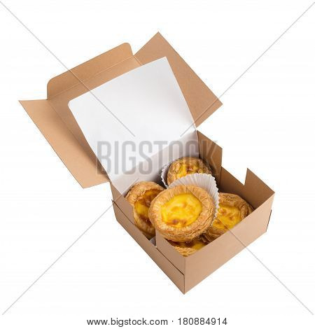 creamy egg tart with sweet curstard in a box isolated on white background