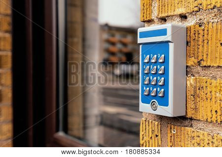 Outdated intercom device at apartment building entrance selective focus