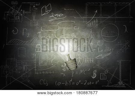 Bulb Illuminates mathematics and business icons on the school chalk board. 3d illustration.