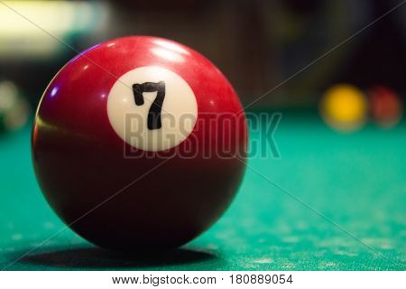 Red Billiard Ball At Number 7 Lies On The Billiard Table.