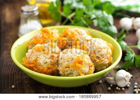 Chicken meatballs with rice braised in vegetables