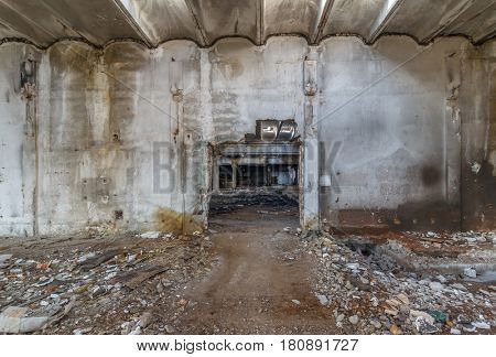 Interior of old factory buildings destroyed. Ruins of industrial enterprise abandoned.