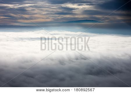Above the clouds, high in the sky above Pacific Ocean