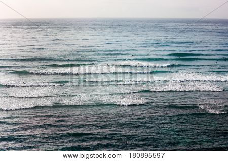 Gentle waves on Pacific Ocean off Oahu island early in the morning
