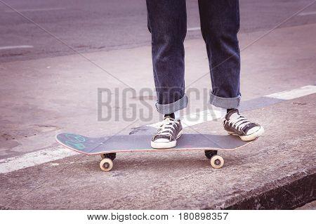 The skateboarder skateboarding at city on street