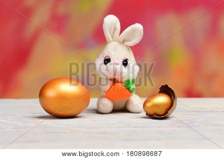 Rabbit Toy, Golden Easter Eggs On Tree Bark Background