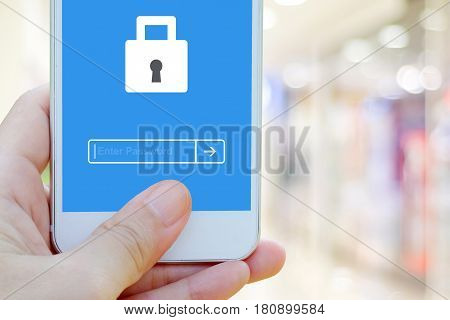Hand holding smart phone with password login on screen background cyber security concept