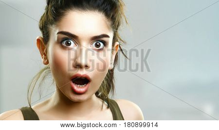 Face of surprised shocked young girl