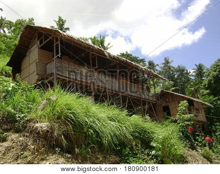huts on the Cliff side, Digos, Philippines Houses precariously positioned on the cliffsides often baffles bypassers