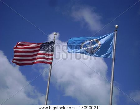 US and CNMI flags The flags of the United States and the Commonwealth of Northern Mariana Islands flying side by side