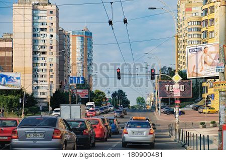 Kiev, Ukraine - September 11, 2016: View of a busy traffic at Viacheslava Chornovola Street. Car drivers are waiting for the green signal at the crossroad