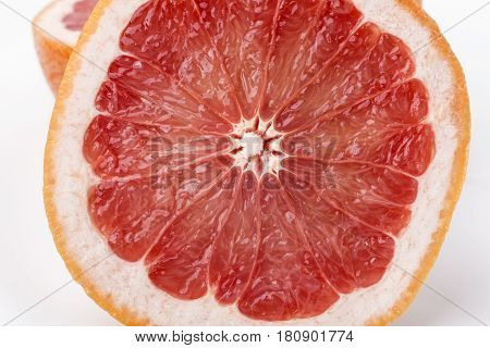highly detailed juicy red grapefruit slice on white