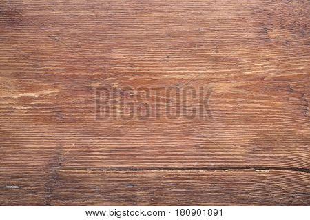 vintage varnished wooden table surface with big crack