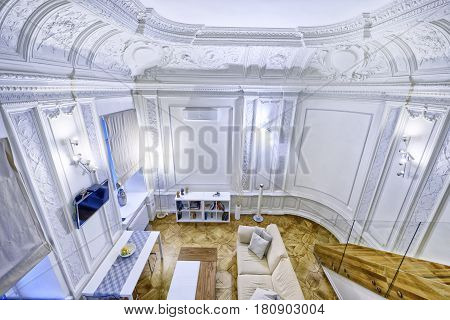 Classic interior design duplex apartment with white wall and ceiling moldings.living room.