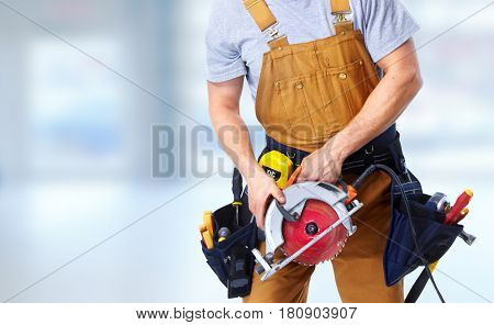 Construction worker with electric saw