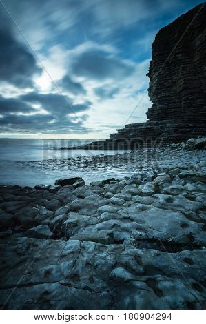 Rocks on the coast next to the cliff face at Nash Point Glamorgan coast Wales