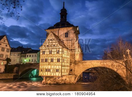 Famous Bamberg Town Hall With Regnitz River At Night, Bavaria, Germany
