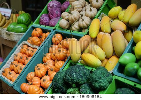 A variety of fruits which are put in many containers for selling.