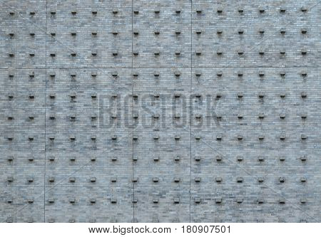 Pattern of gray granite tile wall on the building