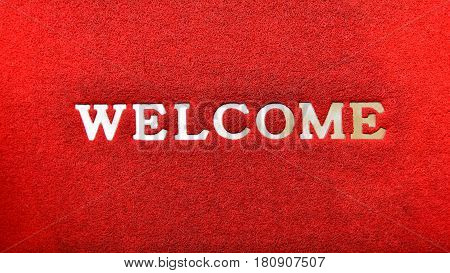 Welcome wording on red grunge door mat