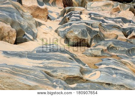 Multiple layers river brown stone and sand