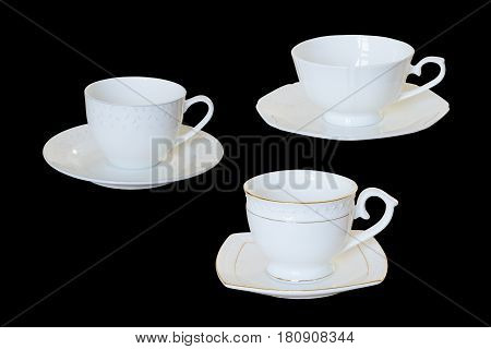 White porcelain cup with a saucer for tea or coffee demitasse or teacup. Isolated, black background.