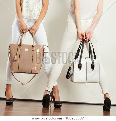Two Slim Women In With Leather Bags Handbags.