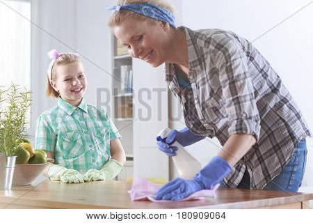 Girl Ready To Help Her Mother Cleaning