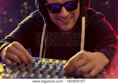 Disc Jokey At Turntable