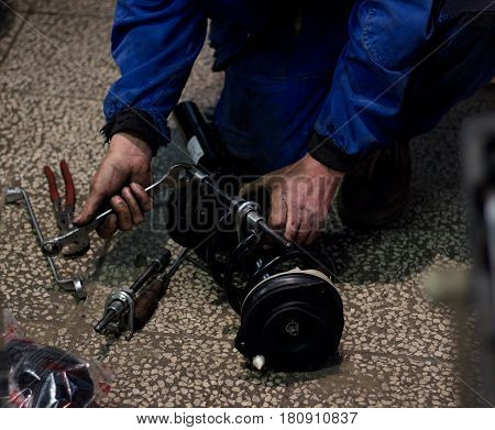 hand of mechanic repair the car spring shock absorbers