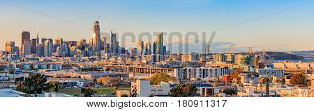 San Francisco, California, USA - April 8, 2017: San Francisco city skyline panorama at sunset with Bay Bridge and new construction