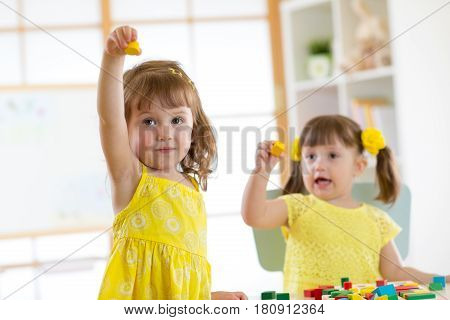 Caucasian children friends playing with educational toys together