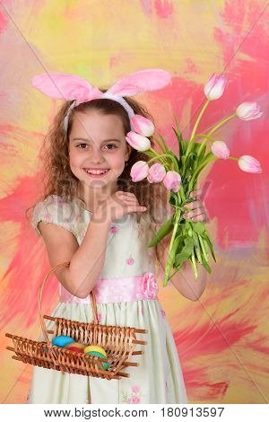 Happy Easter Girl With Colorful Eggs And Tulip Flowers