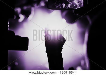 blurred Capture video at a concert at the camera in a bright spotlight lamps