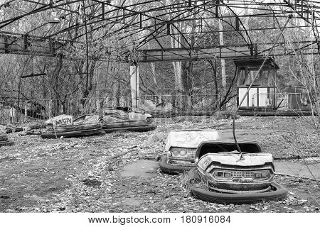 Rusted bumper cars in Pripyat city, Ukraine black and white